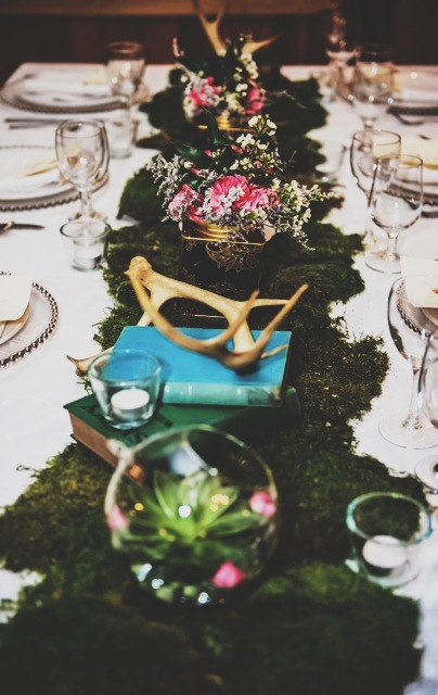 Rustic tablescape with moss runner and antlers